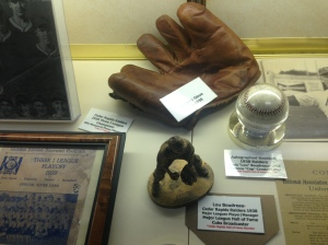 In a case of old memorabilia with Lou Boudreau statue
